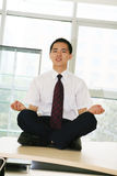 Young businessman sit in office Stock Images