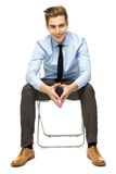 Young businessman sitting Stock Images