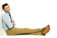Young businessman sitting Stock Photos