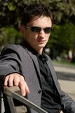 Young businessman sitting on a bench Stock Photos