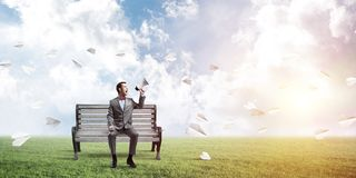 Businessman in summer park announcing something in loudspeaker and paper planes fly around royalty free illustration