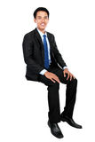 Young businessman sitting on blank space Royalty Free Stock Images