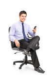 Young businessman sitting on a chair Stock Photos