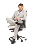 Young businessman sitting in chair Stock Images