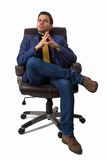 Young businessman sitting on a chair Stock Photography