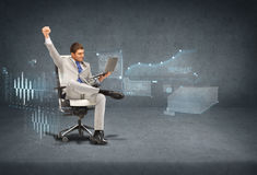 Young businessman sitting in chair with laptop. Business, internet and technology concept - young businessman sitting in chair with laptop with virtual screens Stock Photos