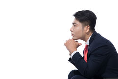 Young businessman sitting on chair over white background, lookin. G away, thinking Royalty Free Stock Photos