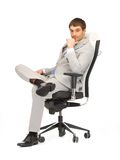 Young businessman sitting in chair Stock Photo