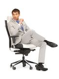 Young businessman sitting in chair Royalty Free Stock Photo