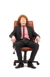 Young businessman sitting in chair Stock Photography