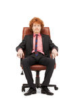 Young businessman sitting in chair Royalty Free Stock Photos