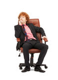 Young businessman sitting in chair Royalty Free Stock Images