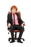 Young businessman sitting in chair Stock Image