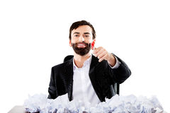 Young businessman sitting with crushed sheets. Stock Image