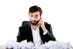 Young businessman sitting with crushed sheets. Stock Photo