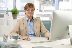 Young businessman sitting at desk Stock Photography