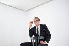 Young Businessman Sitting in Empty Room Royalty Free Stock Photos