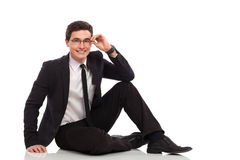 Young businessman sitting on the floor. Royalty Free Stock Image