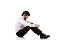 Young businessman sitting on the floor. Stock Photos