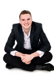 Young businessman sitting on the floor Royalty Free Stock Image