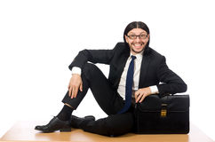 The young businessman sitting on the floor  on white Royalty Free Stock Photo