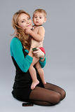Young businessman sitting on her mother hands Royalty Free Stock Image