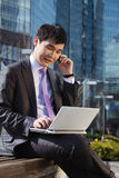 Young businessman sitting with laptop. Royalty Free Stock Photo