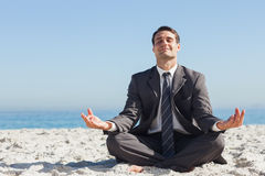 Young businessman sitting with legs crossed relaxing Stock Photography