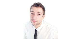Young Businessman sitting and looking up. Portrait of young businessman sitting and looking up isolated on white Stock Photos