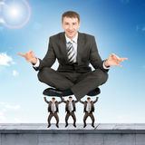 Young businessman sitting in lotus posture Royalty Free Stock Images