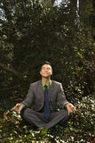Young Businessman Sitting in Meditation Royalty Free Stock Photos