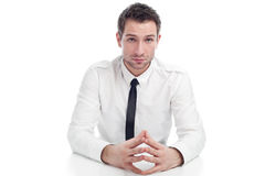 Young Businessman sitting with serious face Stock Image