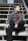 Young businessman sitting on stairs Stock Photos