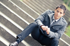 Young businessman sitting on stairs Stock Image