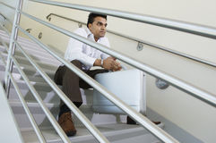 Young Businessman Sitting On A Stairway Royalty Free Stock Photography