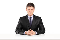 Young businessman sitting at a table Royalty Free Stock Photography