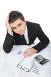 Young businessman sitting and working with documents. Royalty Free Stock Photo