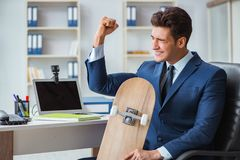 The young businessman with skate in office in sports concept. Young businessman with skate in office in sports concept Royalty Free Stock Photos