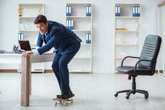 The young businessman with skate in office in sports concept. Young businessman with skate in office in sports concept Stock Photos