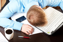 Young businessman sleeping on his table. This is image of a young businessman sleeping on his table stock image