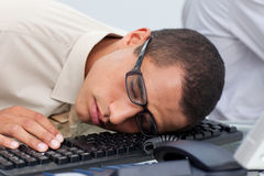 Young businessman sleeping on the keyboard Royalty Free Stock Image