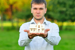 Young businessman with a small house Royalty Free Stock Image
