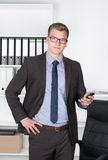 Young businessman with smart phone Royalty Free Stock Photo