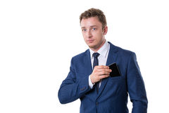 Young businessman with smart phone. Isolated Stock Image