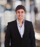 Young businessman smiling Stock Photo