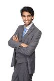 Young businessman smiling with arms crossed Stock Photo