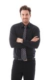 Young businessman smiling arms crossed Royalty Free Stock Photo