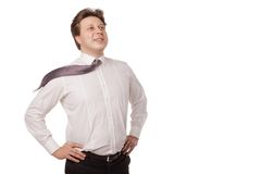 Young businessman smiling with blowing necktie stock photography