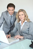 Young businessman with smiling businesswoman Stock Image