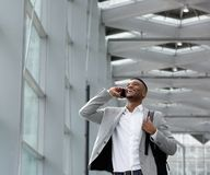 Young businessman smiling and calling by mobile phone Stock Image